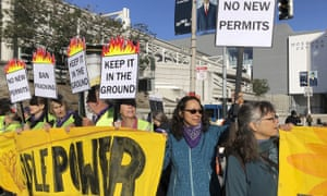 People protest outside the Moscone center in San Francisco on 13 September.