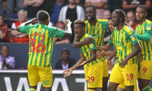 West Bromwich Albion players celebrate with Grady Diangana, centre, after he made it 1-1 against Luton Town.