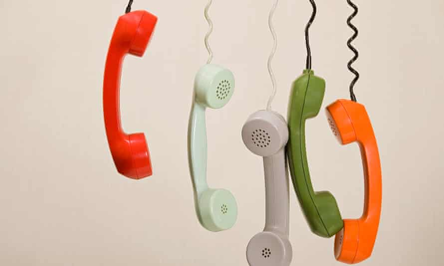 Telephone handsets dangling in a row