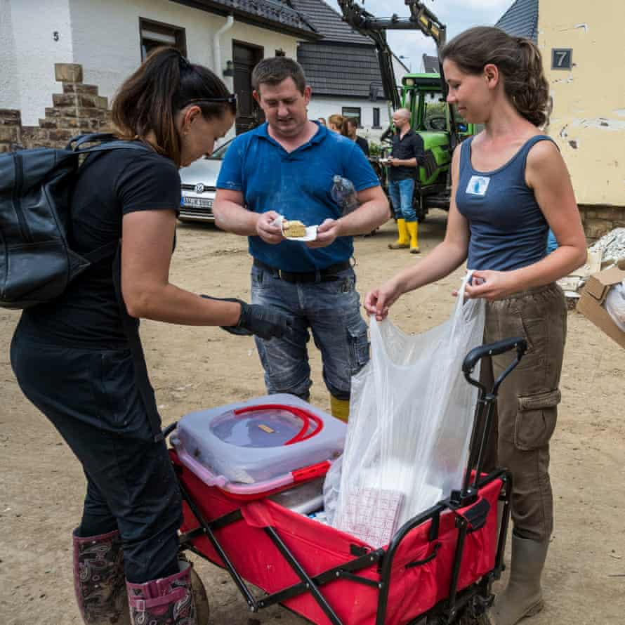 Helper distributes cake