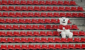 The Rennes mascot sits in the stands at a sadly empty arena.