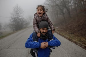 Bosanska Bojna, Bosnia-Herzegovina – A father carries his daughter as they approach the Croatian border in an attempt to cross into the European Union. The family crossed into Croatia only to be pushed back into Bosnia by police a few hours later. There are currently some 3,000 refugees with children sleeping in abandoned houses and temporary accommodation in sub-zero temperatures in northern Bosnia.