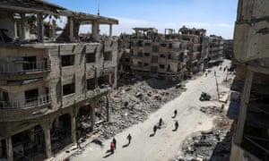 A devastated street in Douma on Friday.