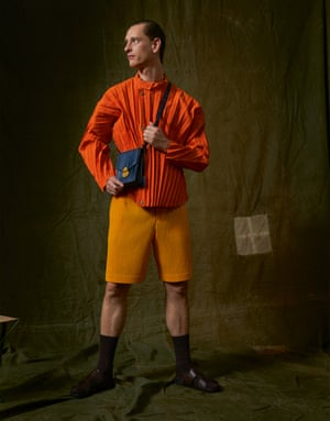 Jacket, £670, and shorts, £250, by Homme Plissé by Issey Miyake. Bag, £595, by Smythson. Socks, £8.99 for three pairs, by Glenmuir from SockShop. Sandals, £150, by Grenson