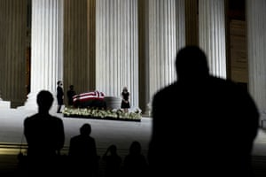 Visitors wait in line to view the casket of the late supreme court justice Ruth Bader Ginsburg in Washington DC, US