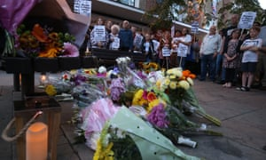 People attend a vigil in Harlow, Essex, to pay tribute to Arkadiusz Jóźwik, a Polish man killed in a possible hate crime attack in August.