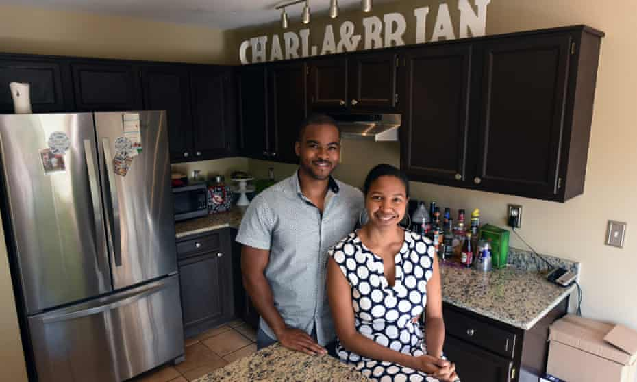 Brian and Charla Freeland stand inside their kitchen.