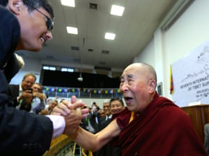 The Dalai Lama, Tibet's exiled spiritual leader, greets the Chinese dissident Chen Guangcheng during an international conference of Tibet support groups in Brussels