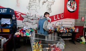 A volunteer sorts food donations for at-risk people in Barcelona, Spain, 6 April 2020