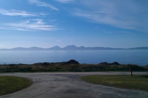 The view of the isles of Jura and Islay from Port Ban, Argyll, Scotland. Breath-taking mountains over the sea, a constantly changing landscape and sea-scape, awesome sunsets, rainstorms, rainbows and cloud formations, plus the chance of seeing otters, gannets and other wildlife all in one.