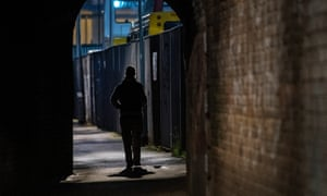 A prostitute waits for a customer on the streets of Holbeck