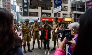 Members of historical group Watershed pose in Hong Kong during an event marking 75 years since the British surrendered to the Japanese during World War II.