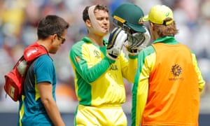 Alex Carey gets patched up after being struck his helmet by a Jofra Archer delivery at Edgbaston.