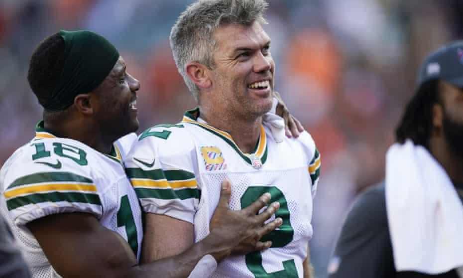 Mason Crosby (2) is congratulated by wide receiver Randall Cobb after kicking the winning field goal