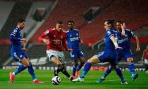 Mason Greenwood gets away from Ayoze Perez (left) and Caglar Soyuncu of Leicester City before firing in Manchester United's equaliser.