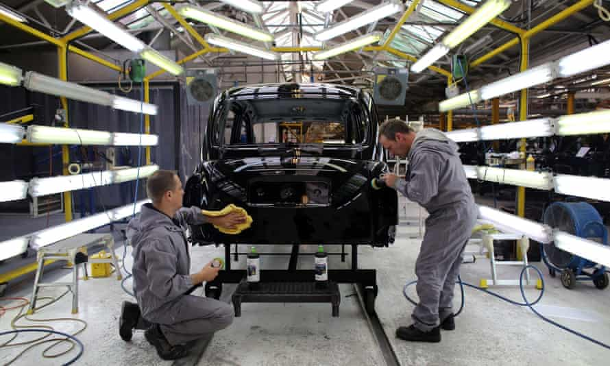 Workers making a black cab inside the factory of the London Taxi Company factory.