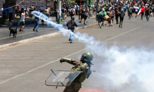 A member of the security forces throws a teargas canister during a protest in Valparaiso on Tuesday.