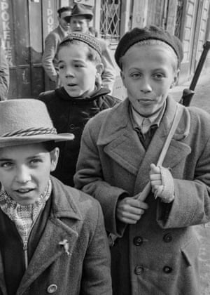Even children were carrying looted weapons as part of the attempt to resist the Soviet tanks