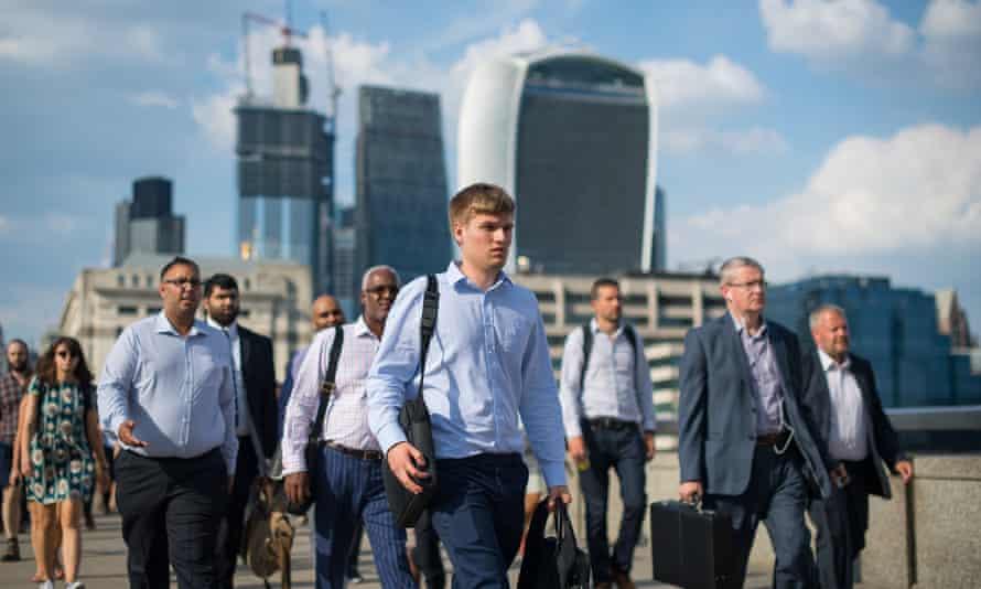 Commuters cross London Bridge