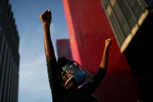 A demonstrator raises her fists during a protest against Brazil's President Jair Bolsonaro in front of the Museum of Modern Art in Sao Paulo.