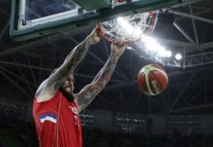 Serbia's Miroslav Raduljica scores.