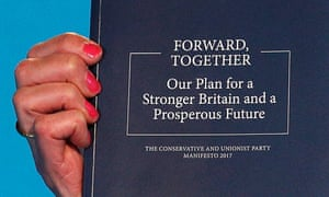 The Conservative party manifesto in 2017, held up by Theresa May.