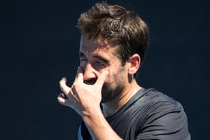 A player winces from getting sweat in his eyes.