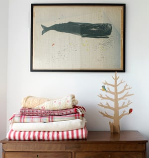 A plywood tree and screenprint by Turley, on a vintage chest