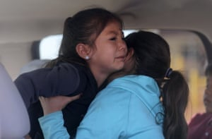 Sophie Hunt gets a hug from her sister after Sophie's Covid-19 test in their grandparents' truck, outside of the Monument Valley Health Center in Oljato-Monument Valley in Utah.