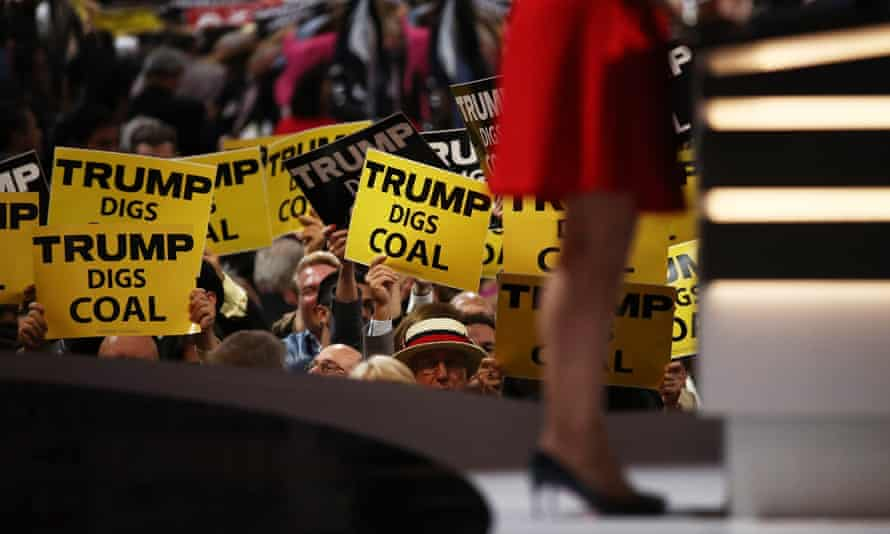 Delegates hold signs that read 'Trump Digs Coal' on the second day of the Republican National Convention