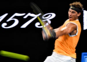 Rafael Nadal pings a forehand back to Alex de Minaur.