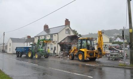 JCB digger outside Royal Oak pub in Penclawdd, Gower,