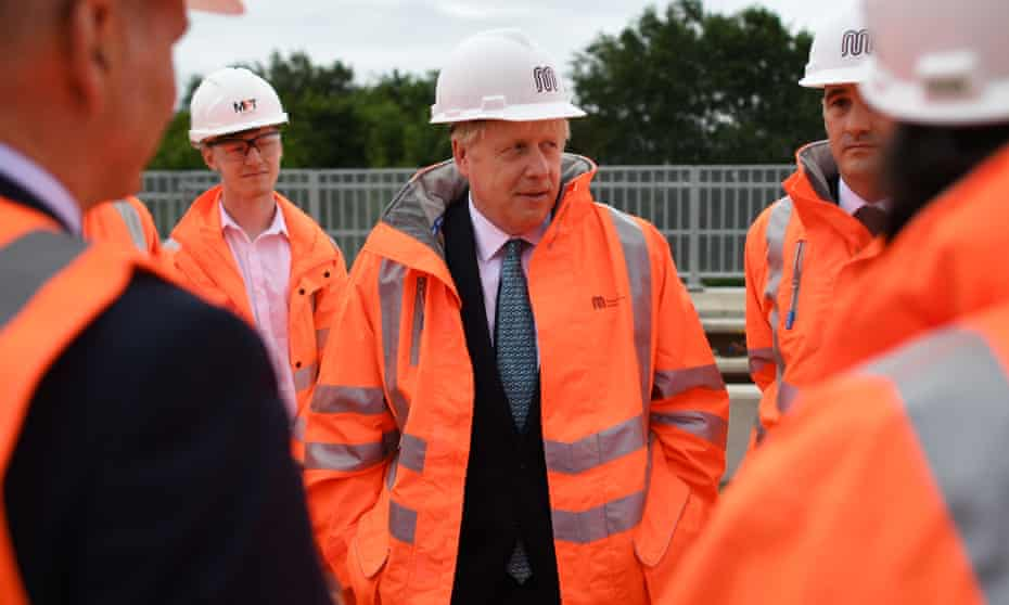 Britain's Prime Minister Boris Johnson meets engineering graduates on the site of an under-construction tramline in Stretford on July 27, 2019 in Manchester, England.