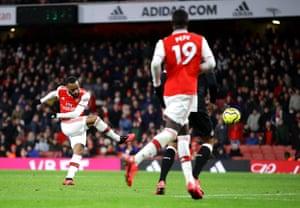 Alexandre Lacazette of Arsenal scores his sides fourth goal.