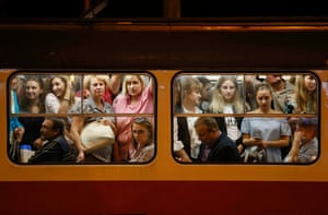 Rush-hour commuters cram into a tram