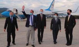 US Health Secretary Alex Azar (2nd L) waving following his arrival at the Sungshan Airport in Taipei.