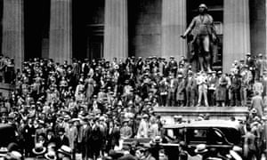 Investors gather outside the New York Stock Exchange on 24 October 1929, five days before the worst crash in Wall Street history