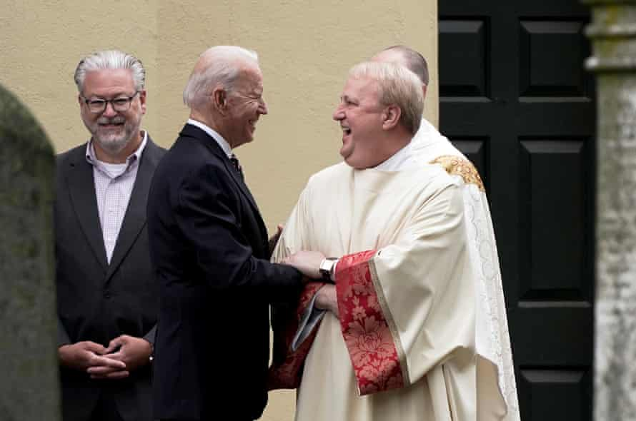 President Joe Biden speaks with a priest outside St Joseph on the Brandywine Catholic Church, in Wilmington, Delaware, on 30 May 2021.