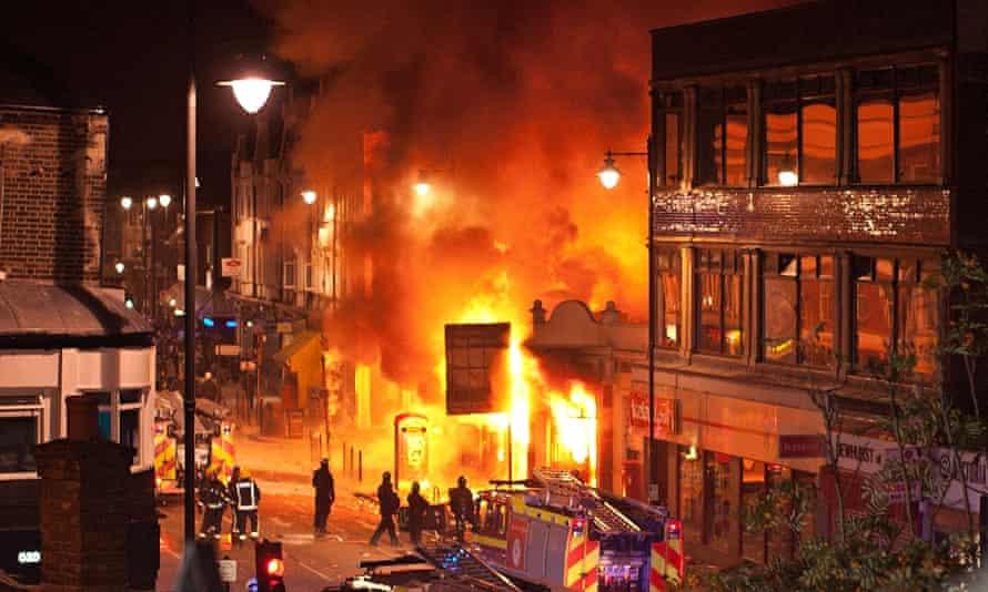 Buildings burn on Tottenham High Road on 6 August 2011.