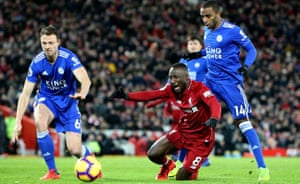 Naby Keïta goes down after a challenge from Ricardo Pereira in the Leicester penalty area.
