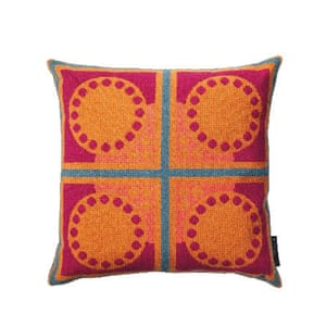 Cushion with red and orange symmetrical patterns