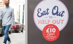 A man walks past a sign advertising the 'eat out to help out' scheme