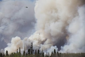 Helicopter dumps water during Canadian wildfires