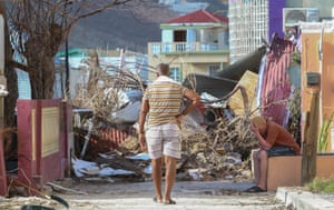 Residents observe the damage left by Hurricane Irma on the Dutch Caribbean island