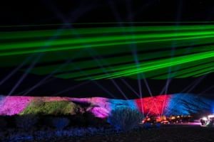 The MacDonnell ranges, which flank Alice to the west and east, formed the backdrop of the display. A 2.5km section of the mountainside was lit, with a laser show above.