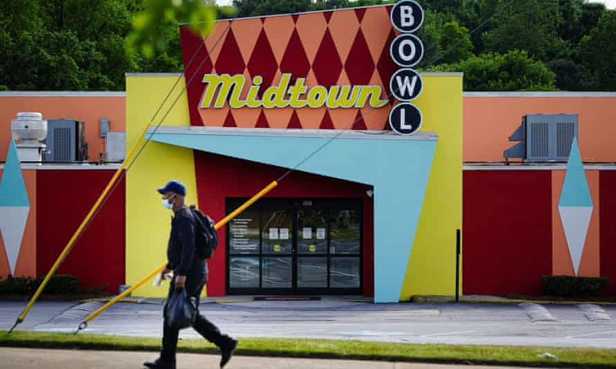 A man walks past the Midtown Bowl bowling alley in Atlanta, Georgia, on Tuesday. Bowling alleys are among businesses the governor, Brian Kemp, has said can reopen on Friday.