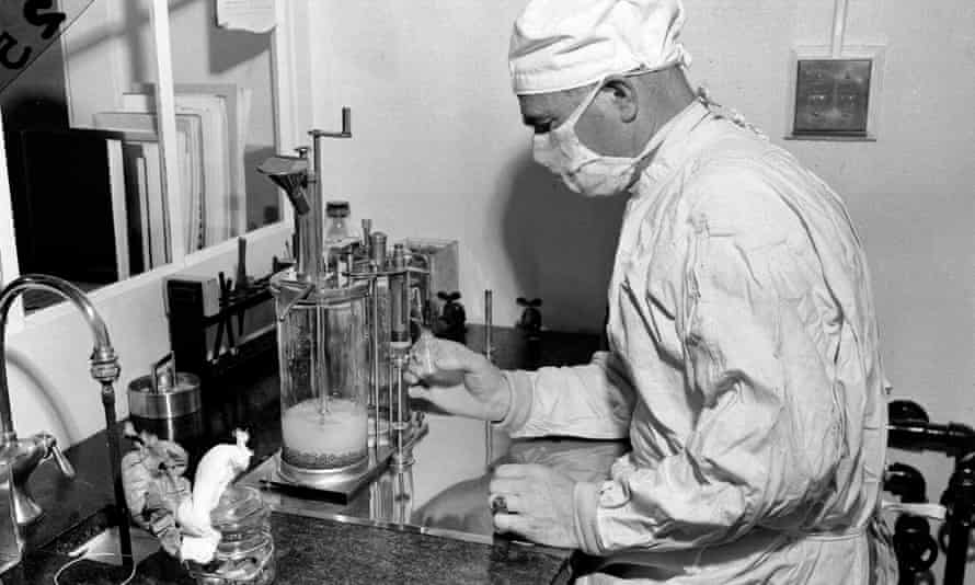 A scientist fills a vial with the BCG vaccine against tuberculosis in Albany, New York in 1947