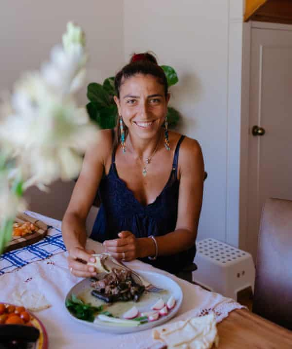 Karima Hazim with a plate of warak enab.