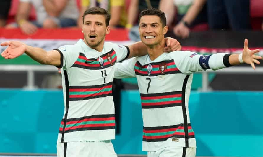 Cristiano Ronaldo celebrates with Rúben Dias after scoring Portugal's third goal against Hungary