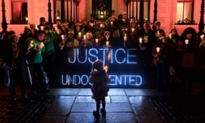 Undocumented adults and children hold a candlelit memorial for loved ones lost in 2015, organised by Migrant Rights Centre Ireland outside the Mansion House in Dublin